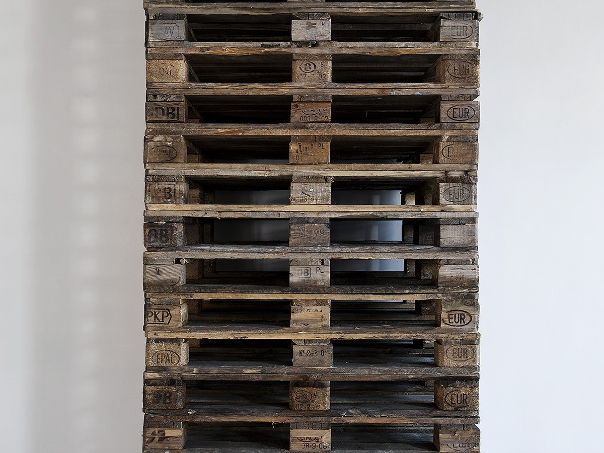 'Monolith', 2011. Stacked wooden pallets